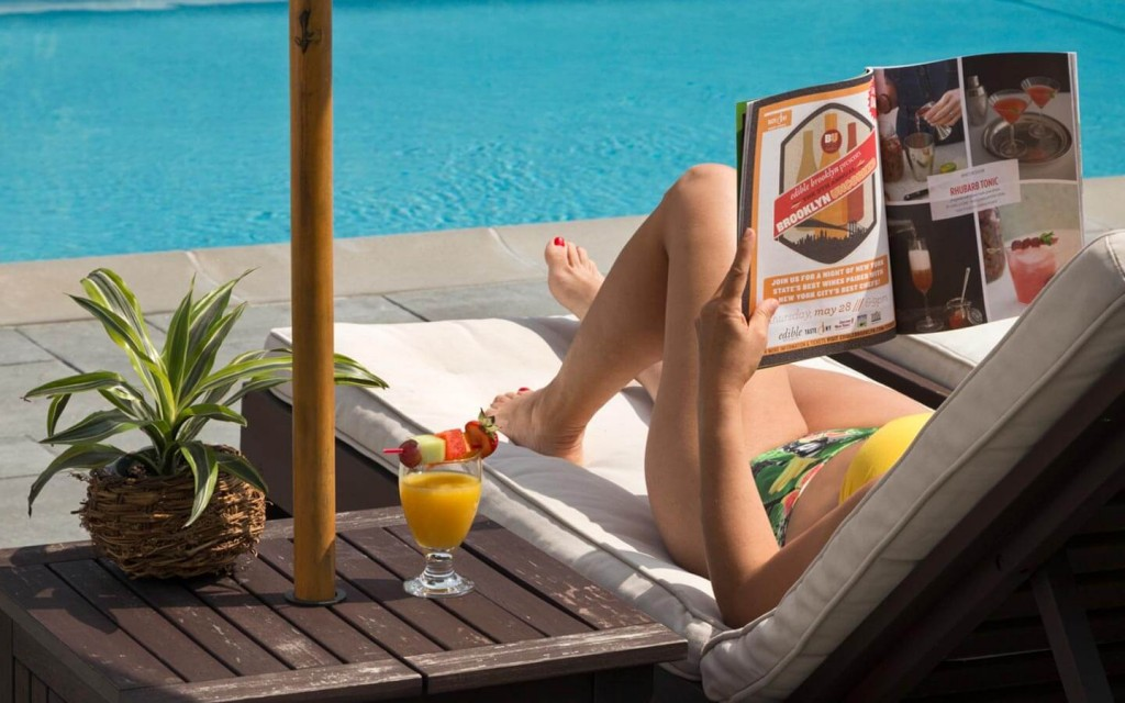 Woman Reading by the Pool at a Shelter Island Hotel