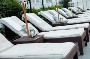 A row of chairs by the pool