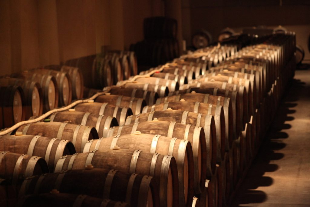 rows of wine barrels at a Long Island vineyard