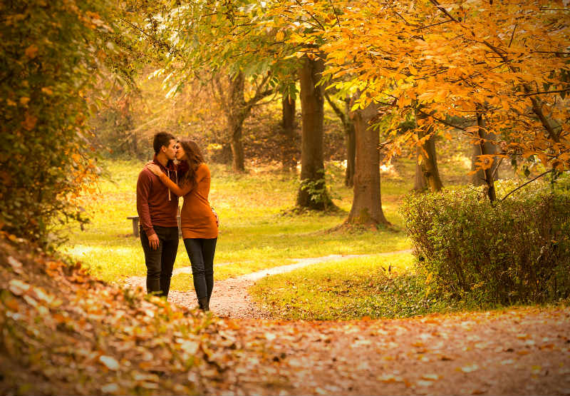 Couple hiking through the fall foliage