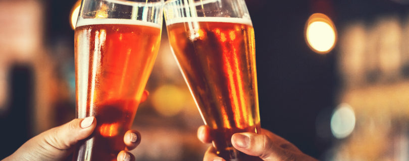 Two Friends Toasting with Two Beers