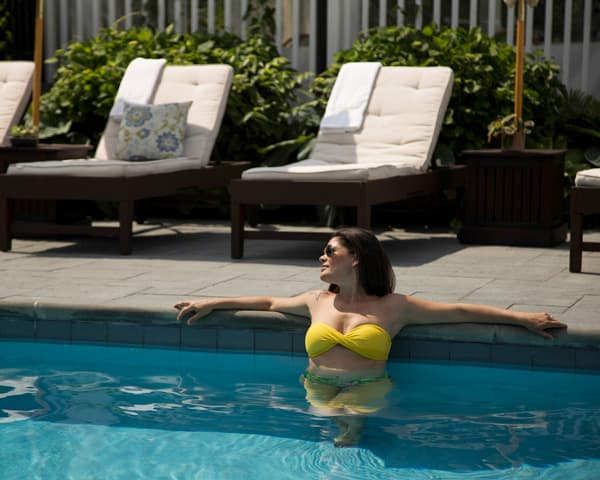 Woman relaxing in the pool at Shelter Island House